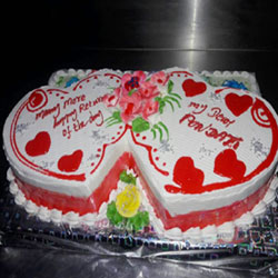 2 kg Pineapple flavoured Cake in a double heart shape arrangement, Suitable for all romantic occasions like Weddings, Anniversaries, Dates etc