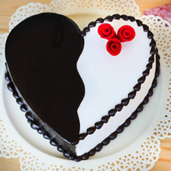 Designed in heart shape and made in irresistible black forest flavor, this 2kg cake is a perfect way to make someone feel special and cherished., Cakes to Delhi