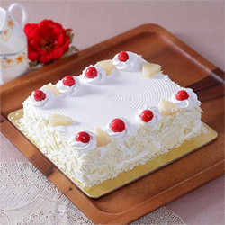 Gift your loved ones this yummilicious White forest cake, which is square in shape and weight  Two kg