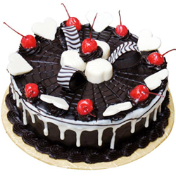 chocolate cake that has creamy chocolate webbing on top along with white chocolate hearts to soothe you and to ensure you indulge in happiness and delightful taste., Cakes to Bangalore