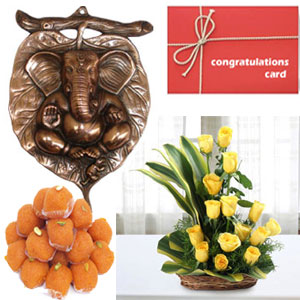 Very prosperous Sidhi Ganesha wall hanging is made of Black metal. Size approx. 12.5 inches. Best Quality Black Metal 20 Yellow roses one side basket 500gms Motichur Laddu packed in gift pack Card