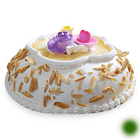 Eggless Special Almond Cake for your beloved birthday. 