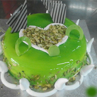 Pista Flavour Cake decorated in flaked toasted almond, Weight : 1kg, eggless
