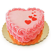 This pink coloured heart shaped cake has a few red hearts on the top. This Strawberry cake is sure to win hearts.