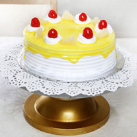 1/2kg kg pineapple cake very delicious rich cake decorated with pineapple Jell and cream cherry fruits , Cakes to Bangalore