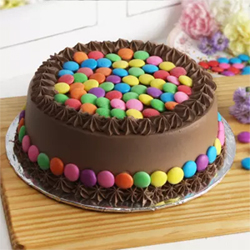 Half Kg Round Chocolate Cake with Chocolate Stars Topping, Cakes to Bangalore