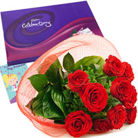 Bunch of 15 Red Roses with green leaves coupled with Cadbury's Celebrations Pack to express your heartfelt feelings and a Greeting Card.