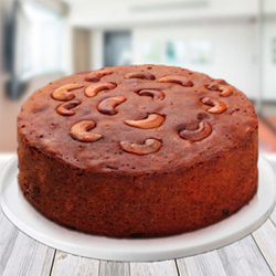 Plum Cake with kaju This Christmas time, extend warm wishes to your friends, family and co-workers with this mouth-watering plum cake
