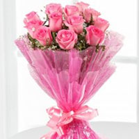 Bouquet of 15 attractive pink roses surrounded by seasonal fillers,, Flowers to Bangalore