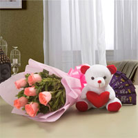 10 Pink Roses bunch Pink Packing Paper 5 Cadbury Chocolates of 13 grams each 1 Soft Toy of 6 inches