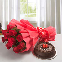 Send a classic expression of love and affection to your dear ones with this gift 1kg chocolate cake + 10 12 red roses bunch