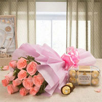 Your Gift Contains: 12 Pink Rose Pink Packing Paper 200 grams Ferrero Rocher Chocolates