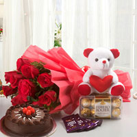 Bunch of 12 Red Roses Red Paper Packing 5 Cadbury Chocolates (12.5 gm each) 6 Inch Soft toy+Ferrero Rocher 200 gms 1/2kg Chocolate Cake