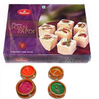 gift of delicious Soan Papdi in a box with four pot diyas.