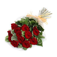 Bunch of 15 Red Roses with seasonal fillers wrapped in cellophane.