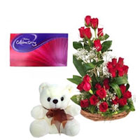 Basket of 20 Red Roses with White Fillers & Greens along with 6 Inch Teddy Bear small celebration box