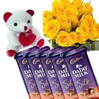 10 Yellow Rose Bunch + small teddy + Cadburys Dairy Milk Silk Fruit and Nut - 5 pieces. Each chocolate wt 65 gms