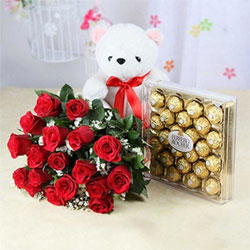 bunch of 18 glorious red roses, an adorable White Teddy 6 Inches and a box of irresistibly divine Ferrero Rocher chocolates.