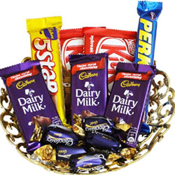 This hamper includes: Basket of 3 Pcs Dairy Milk, 5 Star, 2 Pcs Kit Kat, Perk, 5 Pcs Eclairs.Treat your family and friends to delicious Assorted chocolates.