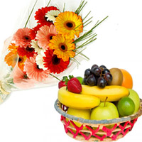 Ten Stems Of Mixed Colours Gerberas Arrange In Abunch With Two Kgs Of Mixed Fruits