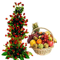 Life Size arrangement of 100 red roses with 5 kg basket of fresh fruits.