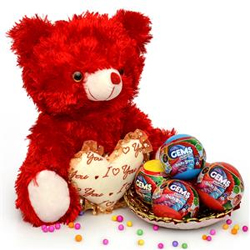 The combo consists balls of chocolate candies & red coloured teddy bear 