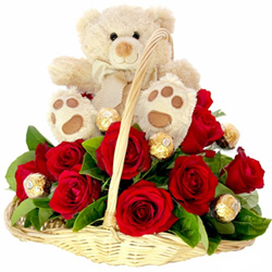 12 red roses and 4 pcs ferrero rocher chocolates bouquet in handle basket with 6inch cream color teddy