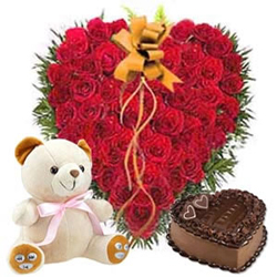 Convey your deepest feeling to your special beautiful gift hamper Soft Teddy (10 inches) and One Kg Heart Shaped eggless Chocolate Cake,100 fresh Dutch Roses in a Heart Shaped Basket