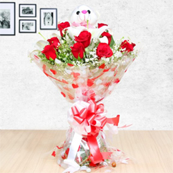 Its a refreshing bunch of 12 fresh red roses and 3 white lilies with one cute teddy bear all in a nice imported-paper packing.