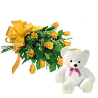 12 yellow roses with green & white fillers and nicely tied by combination ribbon with small teddy Bear