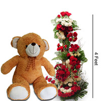 3 Feet tall arrangment of 50 Red Roses, 25 white Roses, 25 Red Carnatoions &  2 feet tall Teddy Bear (color & design of teddy may vary as per availabilty)