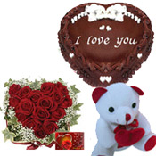 Arrangement of 30 Red Roses in heart shape & 1 Kg Heart Shape Chocolate Cake Teddy bear 6 inches.
