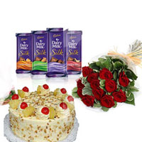 10 Red Roses along with a 1 kg butterscotch cake. Cadbury Dairy Milk Silk (6 Flavors) each one 65 gms