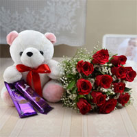 12 Red roses are best for expressing love to your lady along with a cute teddy and Cadbury Silk Chocolates 2 Bars - Weight-65gr
