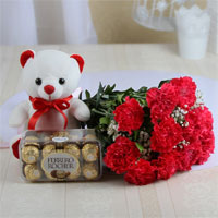bouquet of 12 pink carnations, a 6 inch white teddy bear, and a chocolate box