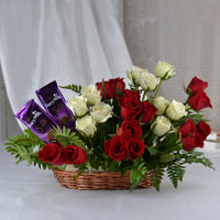 25 Red & White Roses arrangement in a basket, 2 Cadbury dairy milk silk chocolate (Weight: 60 gm)