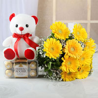 Bunch of 10 Yellow Gerberas With Matching Ribbon Bow Tied and 16 Pcs Ferrero Rocher Chocolate Box with White Teddy (Size: 6 inches)
