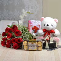 Bunch of 12 Red Rose with matching ribbon bow tied + 16 Pcs Ferrero Rocher Chocolate box + Teddy Bear (Size: 12 inch) + Half kg round shape chocolate cake + Love card