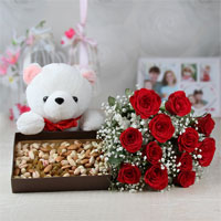 Bunch of 12 Red Roses with Matching Ribbon Bow Tied, White Teddy Bear (Size: 12 inches), 500 Gms of Assorted Dry Fruits in a box