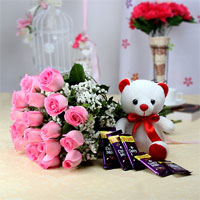 Bunch of 20 Pink Roses With Matching Ribbon Bow Tied, White Teddy Bear (Size: 6 inches) and 5 Bar of Cadbury Dairy Milk Chocolate 75 gms