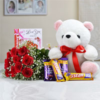 Bunch of 10 Red Roses with matching Ribbon bow tied + Teddy Bear (Size: 12 inch) + Cadbury dairy milk Chocolate (Weight: 30 gm) + 5 Star Chocolate (Weight: 50 gm ) + Love card