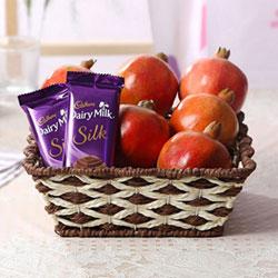 Basket Of 1 Kg Pomegranates  1 Bars Of Cadbury Dairy Milk Silk 60gm (2 units)
