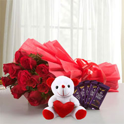 10 Red Rose Red Packing Paper 5 Cadbury Chocolates of 13 grams each 1 Soft Toy