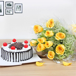 Black forest cake and 10 yellow roses in blue paper packing Send your loved ones this beautiful and awesome treat