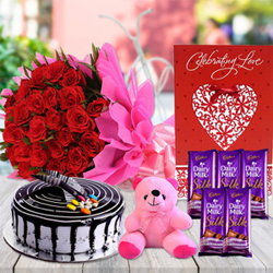 6 inch pink teddy bear,25 red roses in 2 layer pink paper packing,5 Dairy Milk Silk Chocolates(70 gm each),Large Valentine Card and Choco Vanilla Cake Let your special