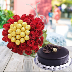 30 Red Roses with 16 ferrero Rochers and Plain 1/2kg Chocolate Cake A beautiful combination of flowers with ferrero rocher and cake