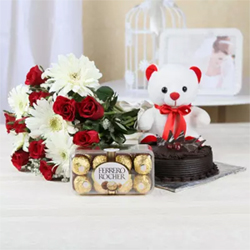 hamper of 15 mixed flowers, neatly tied in a bunch, paired with half kg chocolate cake, and a box of Ferrero Rocher.