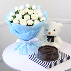 bunch of 20 white roses, a 6-inch teddy bear, and a 500 gms of tempting chocolate cake, has been designed as a perfect flower hamper.