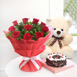 A Bunch of 12 Red Roses with Half Kg Black Forest Cake and 10 ins Teddy Bear