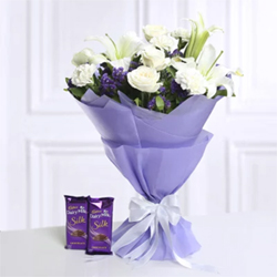 Bouquet of Mix Flowers White 4 Roses, 2 Lilies , 4 Carnation In Tissue Wrapping Cadbury Dairy Milk Silk 60gms (2 units)